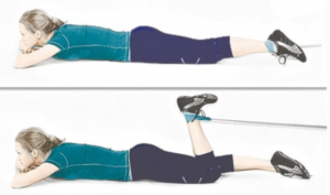 Home exercises with rubber (espander) for legs and buttocks.
